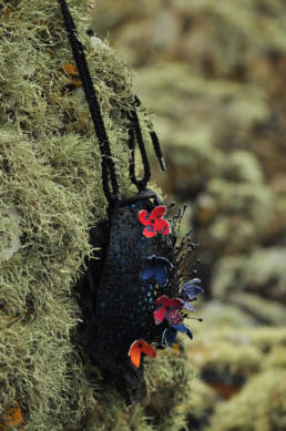 The purse created with a 3D doodle pen combined with 3D printed elements covered with recycled ties